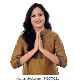 An Indian woman with namaste gesture