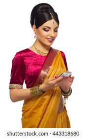 Indian woman with phone isolated on white