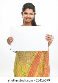 Indian woman in sari holding the white placard