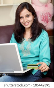 Indian woman shopping on line from home