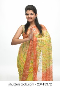 Indian woman in a tradition sari with welcome expression