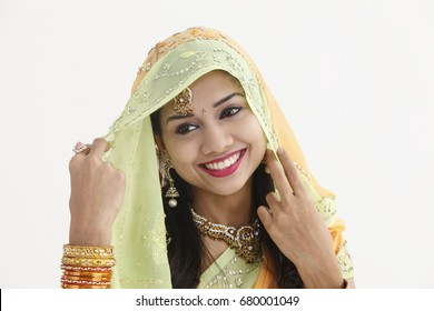 Indian woman in traditional clothing cover herself with scarf