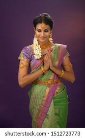indian woman wearing bride look in studio lighting