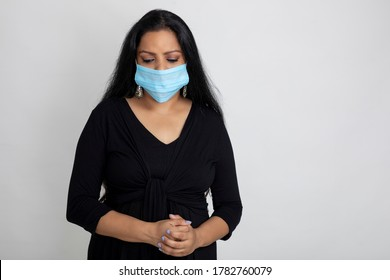 Indian woman wearing Covid protection mask