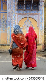 Indian women in colorful sarees walking on street in Jaipur, India. Jaipur is the capital and largest city of the Indian state of Rajasthan.