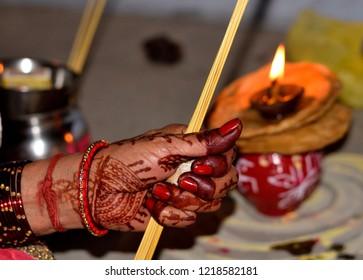 Indian women doing karwachauth pooja in traditional way