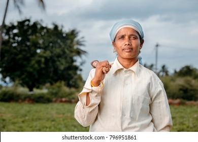 Indian women farmer portrait on farm field.