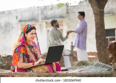 Indian Women using laptop at village