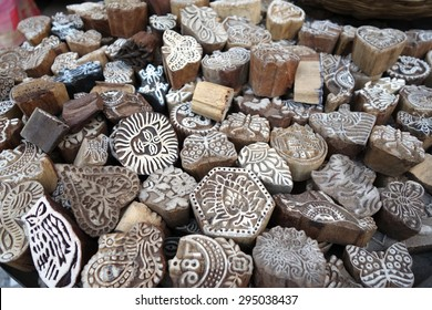 Indian wood printing blocks for sales in local stall in Varanasi, India.  Wood printing blocks are used for textile blocked printing.
