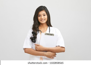 Indian young female doctor holding notepad