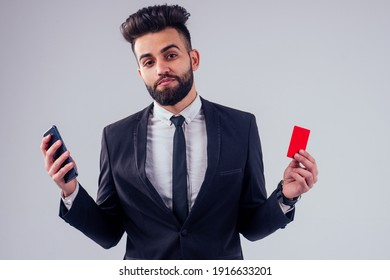 indian young handsome black hair man in stylish business suit holding credit card in studio isolate white background.contactless payment concept