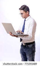 Indian young man with laptop , Working on Laptop