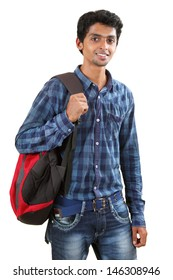 Indian young student carrying bag on white.