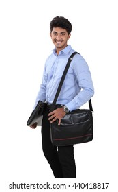 Indian young student carrying file and laptop bag on white.