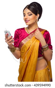 Indian young woman with mobile phone isolated