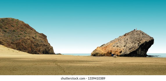 indiana Jones movie stage and the last crusade, tongues of lava eroded by the sea, the auto clastic gaps or pyroclastic andesite, The petrified wave, beach of Mónsul, Natural Park, Cabo de Gata, spain