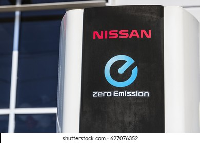 Indianapolis - Circa April 2017: Electric Vehicle Quick Charger at a local Nissan Car Dealership. The Nissan LEAF EV is a best-selling vehicle III