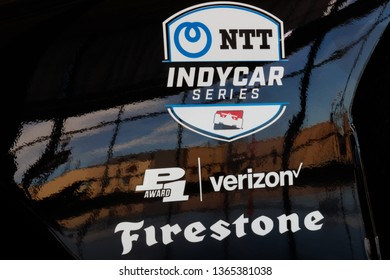 Indianapolis - Circa April 2019: Logo of NTT IndyCar series and sponsors Firestone and Verizon. IndyCar is the premier level of open-wheel racing I