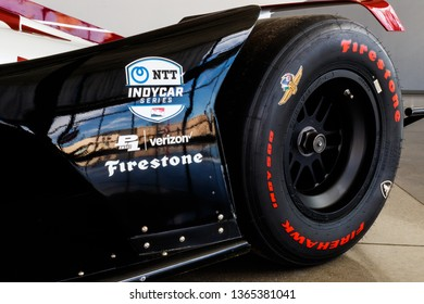 Indianapolis - Circa April 2019: Logo of NTT IndyCar series and sponsors Firestone and Verizon. IndyCar is the premier level of open-wheel racing II