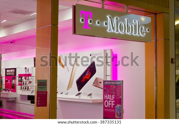 Indianapolis - Circa February 2016: T-Mobile Retail Wireless Store. T-Mobile is a Wireless Provider Offering Cell Phones, Data Plans, Internet Devices & Accessories III