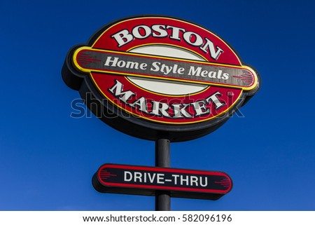 Indianapolis - Circa February 2017: Logo and Signage of a Boston Market Fast Casual Restaurant. Boston Market is owned by private equity firm Sun Capital Partners I