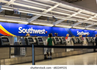 Indianapolis - Circa July 2017: Southwest Airlines Check In desk preparing passengers for departure. Southwest is the largest low-cost carrier in the world IV