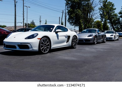 Indianapolis - Circa July 2018: Local Porsche Dealership displaying new SUVs. Porsche Racing dates to the 1950s V