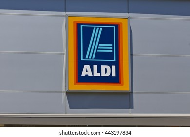 Indianapolis - Circa June 2016: Aldi Discount Supermarket. Aldi sells a range of grocery items, including produce, meat & dairy, at discount prices VI