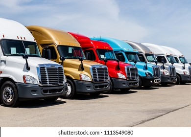 Indianapolis - Circa June 2018: Colorful Freightliner Semi Tractor Trailer Trucks Lined up for Sale. Freightliner is owned by Daimler AG Trucks II