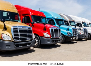 Indianapolis - Circa June 2018: Colorful Freightliner Semi Tractor Trailer Trucks Lined up for Sale. Freightliner is owned by Daimler AG Trucks IV