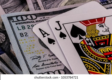 Indianapolis - Circa March 2018: Closeup of a Blackjack 21 hand on a bed of one hundred dollar bills III