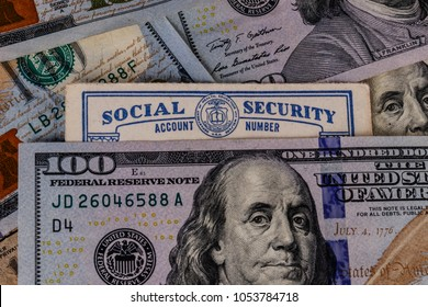Indianapolis - Circa March 2018: Old Social Security card and a bed of money representing the high cost of living on a fixed income III