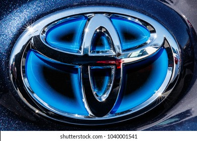 Indianapolis - Circa March 2018: Toyota blue hybrid vehicle logo and badge. Toyota is a high quality Japanese auto manufacturer III