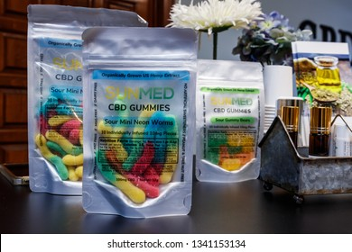 Indianapolis - Circa March 2019: SunMed CBD Infused Edible Gummies. The popularity of CBD oil as a medicinal product has skyrocketed VIII