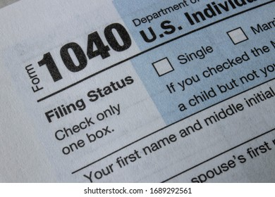Indianapolis - Circa March 2020: 1040 Tax forms from the IRS. Form 1040 is used by U.S. taxpayers to file an annual income tax return.