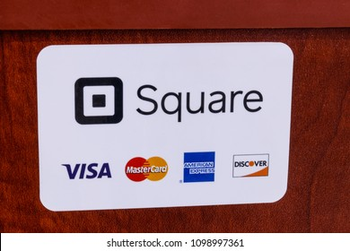 Indianapolis - Circa May 2018: Modern mobile pay and credit methods including Square, Visa, Master Card, American Express and Discover IV