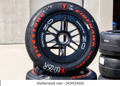 Indianapolis - Circa May 2019: Firestone Firehawk tires prepared for racing. Firestone tires are the exclusive tire of IndyCar III