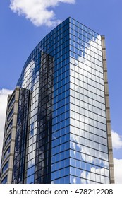 Indianapolis - Circa September 2016: Mirror Tile Window Skyscraper with Blue Sky and White Clouds in Reflection II