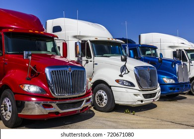 Indianapolis - Circa September 2017: Colorful Red, White and Blue Semi Tractor Trailer Trucks Lined up for Sale