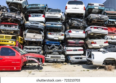 Indianapolis - Circa September 2017: Stacked junk yard clunker cars prepared for crushing to be recycled