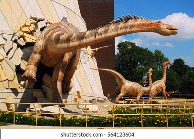 """Indianapolis, IN, USA June 3 A dinosaur """"breaks out"""" of the wall at the Indianapolis Children's Museum in Indianapolis, Indiana"""