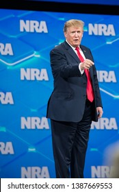 Indianapolis, Indiana / USA - April 26 2019: President of the United States of America Donald Trump Speaks at Annual National Rifle Association NRA Convention Meetings Leadership Forum Points at crowd
