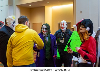 INDIANAPOLIS, INDIANA / USA - CIRCA 2014: Cosplayers at the annual GenCon gaming convention, including the Joker and his gang, and Harley Quinn.