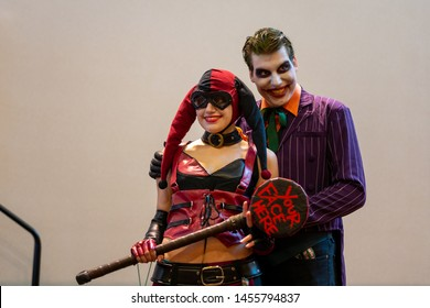 INDIANAPOLIS, INDIANA / USA - JULY 30 2015: Two GenCon gaming convention attendees pose for pictures as Harley Quinn and the Joker from the Batman comics.