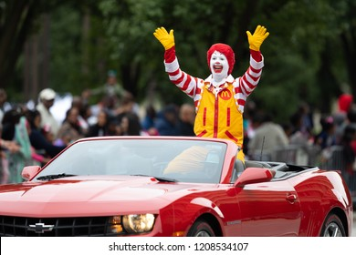 Indianapolis, Indiana, USA - September 22, 2018: The Circle City Classic Parade, Ronald McDonald waving at spectators while going on a camaro down the road