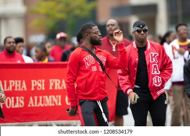 Indianapolis, Indiana, USA - September 22, 2018: The Circle City Classic Parade, Members of the Kappa Alpha Psi Fraternity dancing during the parade