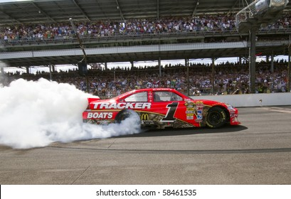 INDIANAPOLIS, IN - JULY 25:  Jamie McMurray does a burn out after winning the Brickyard 400 race at the Indianapolis Motor Speedway on July 25, 2010 in Indianapolis, IN.