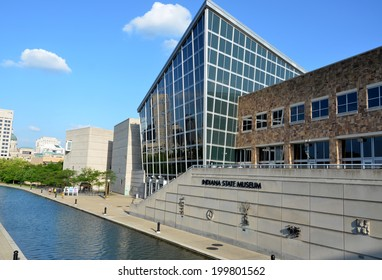 INDIANAPOLIS - JUNE 17:  The Indiana State Museum, shown here on June 17, 2014, includes sculptures representing each of Indiana's 92 counties, including the ones shown on the canal-facing wall.