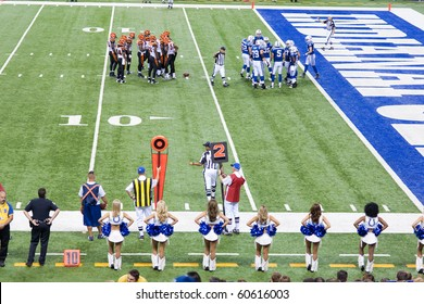 INDIANAPOLIS, IN - SEPT 2: Indianapolis Colt and Cincinnati Bengals huddle during the football game on September 2, 2010 in Indianapolis, IN