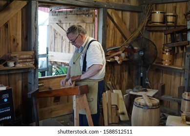 Indianapolis, IN / USA 8/19/19: A cooper (bucketmaker) works on his craft at the Indiana State Fair.